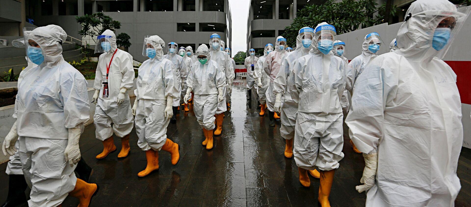 Медицинские работники в средствах индивидуальной защиты в Джакарте, Индонезия - Sputnik 日本, 1920, 22.02.2021