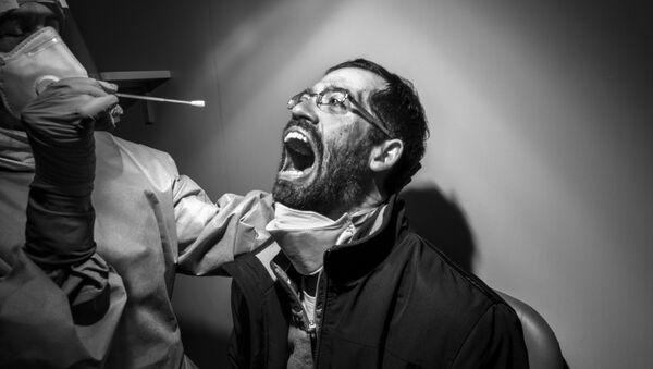 「プロ/ピープル」部門1位受賞作品『A Painful Necessity』Gabriele Micalizzi氏(イタリア)  - Sputnik 日本
