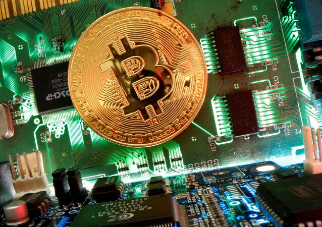 Representation of the virtual currency Bitcoin is seen on a motherboard in this picture illustration taken April 24, 2020