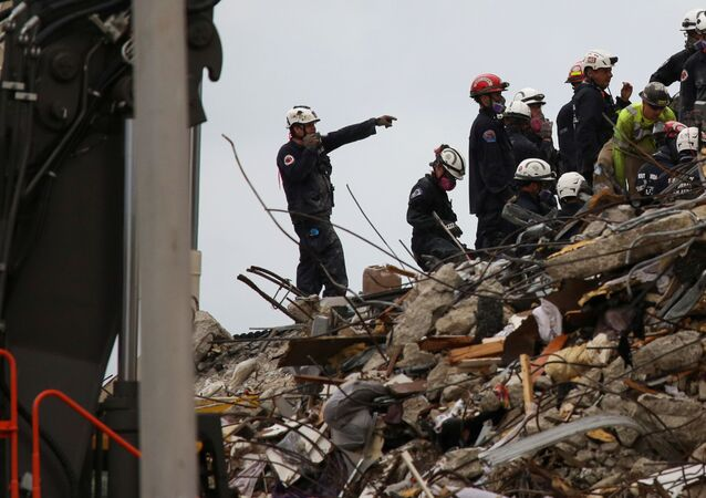 Rescue personnel continue the search and rescue operation for survivors at the site of a partially collapsed residential building in Surfside, near Miami Beach, Florida, U.S. June 30, 2021