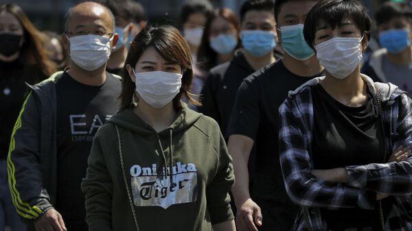 Люди в масках на улице в Пекине - Sputnik 日本