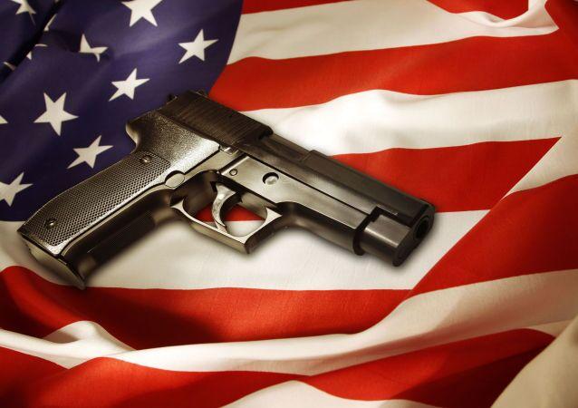 米国旗とピストル