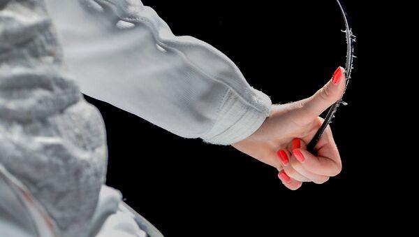 Инна Дериглазова (Россия) во время полуфинального поединка с Арианной Эрриго (Италия) на соревнованиях среди женщин по фехтованию на рапирах на чемпионате мира в Москве - Sputnik 日本
