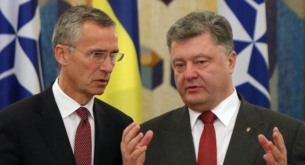 NATO Secretary General Jens Stoltenberg, left, and Ukrainian President Petro Poroshenko talk before the meeting with he media in Kiev, Ukraine, Tuesday, Sept. 22, 2015