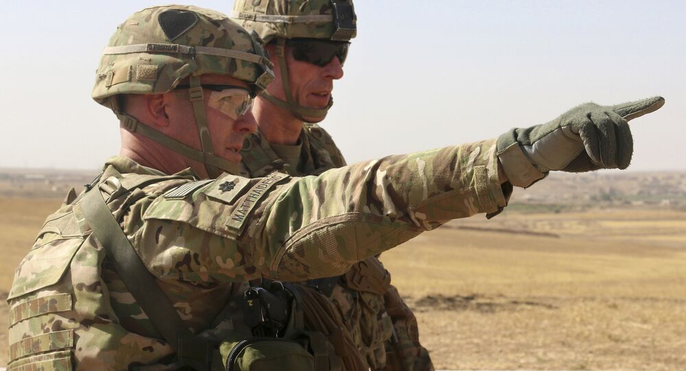 This Oct. 10, 2016 photo released by the U.S. Army shows U.S. Army Lt. Col. Ed Matthaidess, commander, left, Task Force Falcon, outlining areas of an Iraqi security forces tactical assembly area to U.S. Army Maj. Gen. Gary J. Volesky, commander, Combined Joint Forces Land Component Command – Operation Inherent Resolve, in northern Iraq