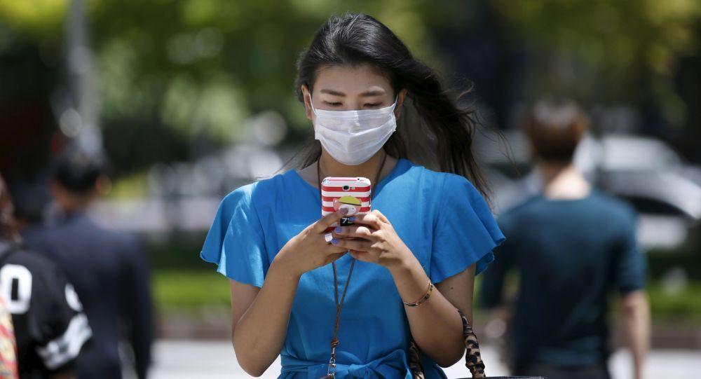 韓国、社会的距離のレベルを引き下げる 5人以上の集まりを禁止