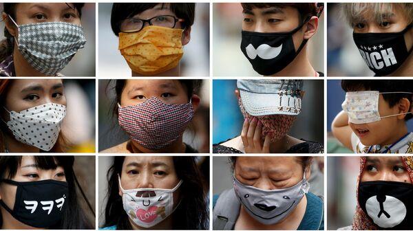 Люди в защитных респираторных масках. Сеул - Sputnik 日本