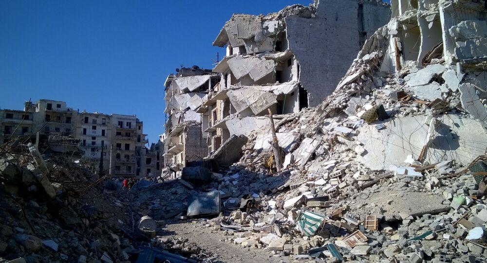 Разрушенные дома в освобожденном районе Аль Сукари в Алеппо