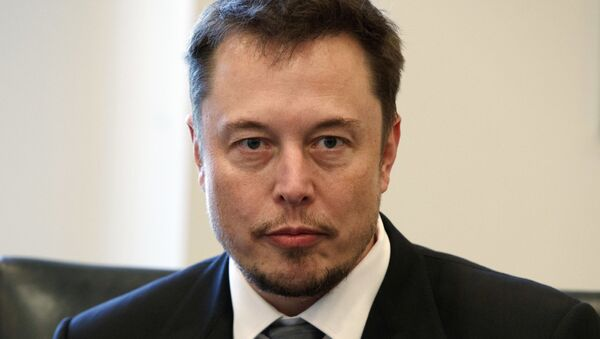 In this Dec. 14, 2016, file photo, Tesla CEO Elon Musk listens as President-elect Donald Trump speaks during a meeting with technology industry leaders at Trump Tower in New York. - Sputnik 日本