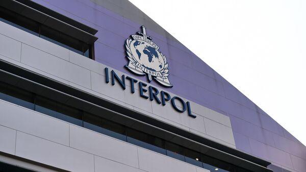 Эмблема Интерпола на стене нового комплекса организации в Сингапуре - Sputnik 日本