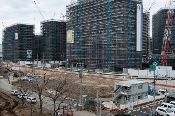 スポーツ関係者らの滞在に向け、ここには14~18階建ての建物が21棟建設されつつある。五輪開催時には1万8千人、パラリンピック開催時には8千人のスポーツ関係者がここに滞在する - Sputnik 日本