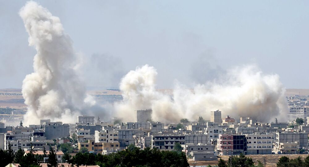 Smoke rises in the Syrian town of Kobani, as pictured from the Turkish side of the border near Suruc, Sanliurfa province, Turkey, June 27, 2015
