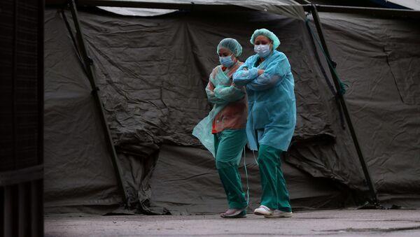 マスクを履いているスペインの医師 - Sputnik 日本